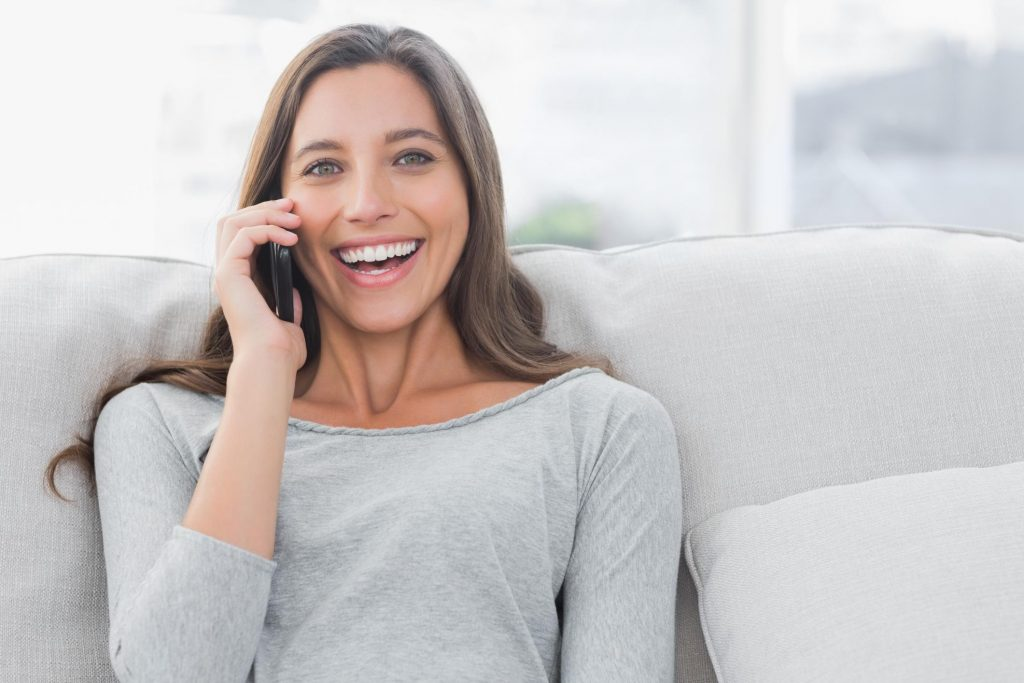 lady happily taking phone call